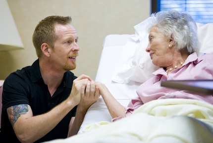Photo of mother in treatment with caregiver son
