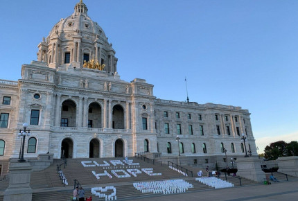 Hundreds of Lights of Hope bags are displayed on the steps of the Minnesota State Capitol