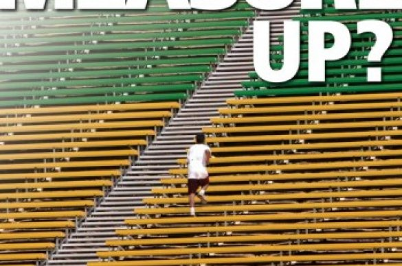 Man walking on sports bleachers