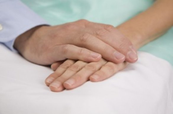 Two people touching hands together
