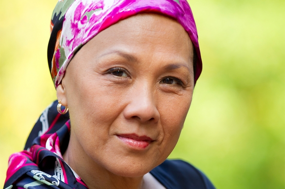 Photo of female Cancer patient with a pink scarf