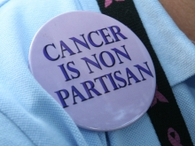 """Photo of American Cancer Society Cancer Action Network Volunteer wearing a button that says """"Cancer is Non Partisan"""""""
