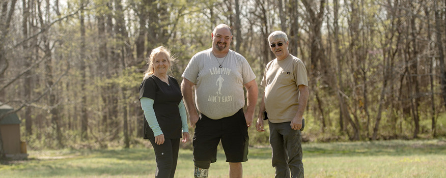 Mississippi patient and family standing in a field