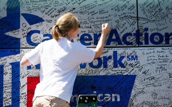 Photo of Fight Back Express bus event participant signing the bus
