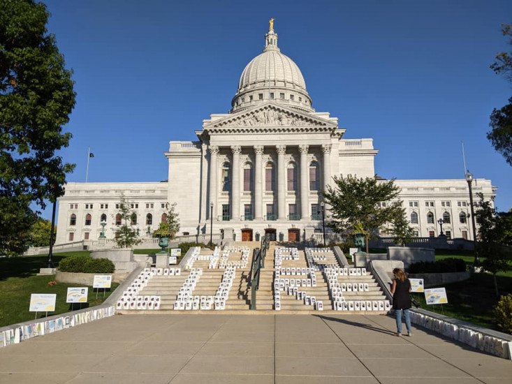 Lights of Hope bags spell the words 'hope' and 'cure' on Wisconsin State Capitol's steps.