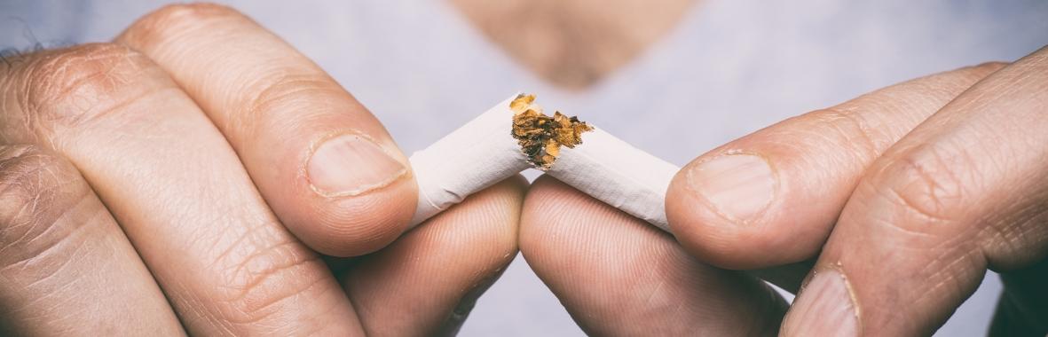 Photo of a woman breaking a cigarette in half
