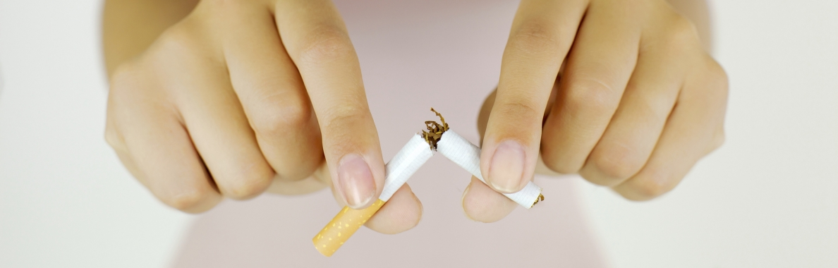 Photo of two hands breaking a cigarette