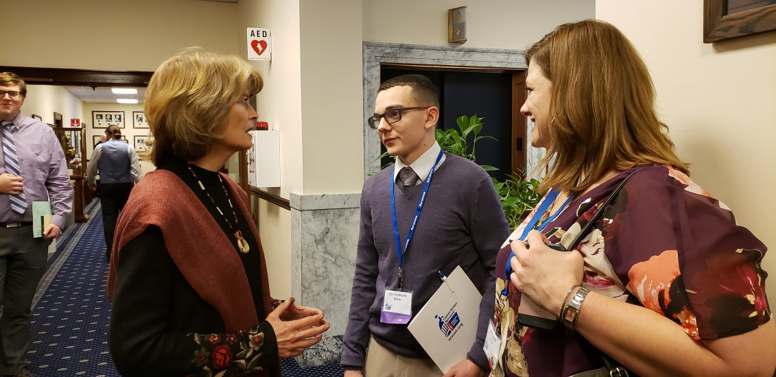 Volunteers Joe Yourkoski and Johna Beech talking with U.S. Senator Lisa Murkowski in the Alaska State Capitol - February 19, 2019