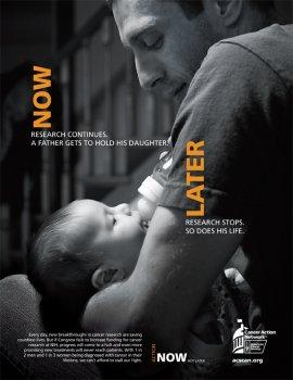 Man feeding baby