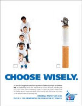 Children standing beside large cigarette