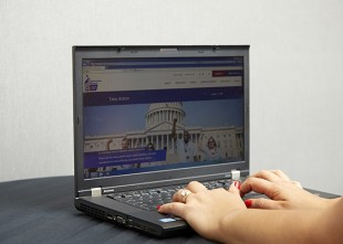 Volunteer using a computer to take action on the ACS CAN website