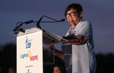 Volunteer speaking at Lights of Hope
